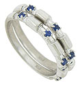 These elegant stackable wedding bands feature elongated notches, each set with a rich blue, round cut sapphire