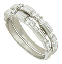 These elegant stackable wedding bands feature elongated notches, each set with a round cut diamond