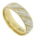 This handsome mens wedding band is crafted of 10K yellow and white gold
