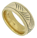 Slashes of engraving cross back and forth across the surface of this 14K yellow gold wedding band