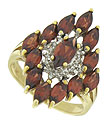 An explosion of marquis cut garnets appear to revolve around a central garnet framed in diamonds
