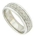 A richly carved crown of acanthus leaves covers the face of this antique style mens wedding band