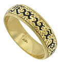 "This handsome estate wedding band is crafted of 14K yellow gold with the word ""kuuipo"" finished in black enamel"