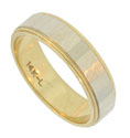 This handsome 14K bi-color wedding band features a central white gold faceted band pressed into the yellow gold ring