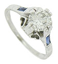 This spectacular Art Deco engagement ring features a gorgeous 1.04 carat, H-I color, Si2 clarity round cut diamond