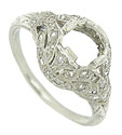 This magnificent antique style platinum mounting is adorned with abstract organic cutwork and engraving