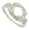 This gorgeous antique style platinum ring mounting features bold cutwork and bow shaped figures on each shoulder