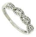 A twisting ribbon of white gold frosted in diamonds adorns the face of this antique style wedding band
