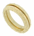 These 14K yellow gold stackable wedding bands curve from the center outwards toward the edges