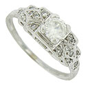 A brilliant .40 carat, GIA certified, G color, Vs2 clarity diamond glows from the face of this antique engagement ring