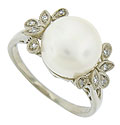 A luminous pearl shimmers in the center of this elegant estate ring