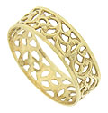 Elegant vining cutwork winds across the surface of this airy wedding band