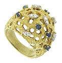This bold, dome ring is fashioned of 14K yellow gold and sprinkled with deep blue sapphires and pairs of fine faceted diamonds