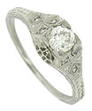 This spectacular antique style platinum engagement ring is set with a fiery .36 carat, H color, Si1 clarity round diamond