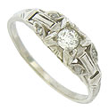This spectacular 18K white gold antique engagement ring is set with a .19 carat, H color, Si2 clarity round cut diamond