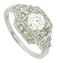 A luminous GIA certified, .85 carat, H color, Si1 clarity diamond glows from the center of this exquisite antique platinum engagement ring