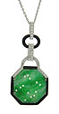 This spectacular octagon shaped Jadeite is framed in black onyx and attached with a handle fashioned of 18K white gold
