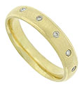 This handsome 14K yellow gold wedding band features a satin finish and is set with a wide string of fine faceted diamonds