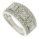 A trio of abstract style flowers are framed in squares of milgrain on the face of this handsome estate wedding band