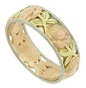 Glorious rose gold blooms and green gold leaves dance across the surface of this stunning 14K tri-color wedding band