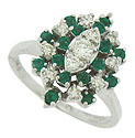 This stunning estate ring features fantastic sprays of fine faceted diamonds and rich green emeralds