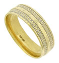 Strings of engraved circles spin across the surface of this elegant 10K yellow gold mens wedding band