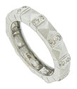 Wide faceted figures alternate with ribbons of fine faceted diamonds on the surface of this elegant estate wedding band