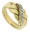 Ribbons of deeply engraved 14K yellow gold twist together to form a wide braid on the surface of this estate wedding band