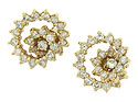 A spinning halo of diamonds forms a flower in these elegant earring jackets