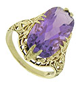 A captivating oval cut amethyst is presented by floral inspired prongs in the face of this antique style ring
