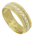 Spiral engraving spins across the center of this handsome 14K bi-color wedding band