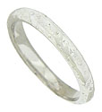 Abstract floral engraving covers the surface of this 14K white gold wedding band