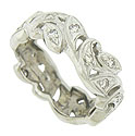 A fabulous ribbon of diamond frosted organic figures press together to form this spectacular antique wedding band