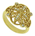 Lacy, floral filigree frosted with diamonds adorns the face of this romantic 14K yellow gold estate ring