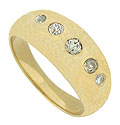 Dazzling round cut diamonds are deep set into the face of this unique 14K yellow gold wedding band