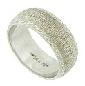 The wide, curving surface of this handsome wedding band is roughly hewn and finished in criss-cross jewel cut engraving