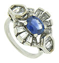This captivating antique engagement ring is fashioned of platinum in the figure of an elegant flower
