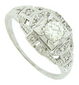 A luminous .30 carat, H color, Si2 clarity diamond glows from the center of this elegant antique engagement ring
