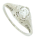 A magnificent .34 carat, F color, Si1 clarity, round cut diamond glows from the center of this breathtaking engagement ring