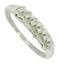 Deep angled scallops adorn the face of this 14K white gold estate wedding band