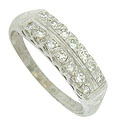 A double row of brilliant, round cut diamonds are set into the face of this handsome antique wedding band