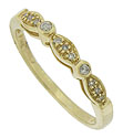 A trio of bezel set diamonds punctuates the face of this elegant 14K yellow gold wedding band