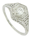 A hexagonal top frames a .21 carat diamond on this platinum antique style engagement ring