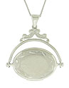 This romantic 14K white gold antique style locket features a hinged, rotating photo compartment
