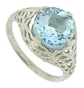 A spectacular round cut aquamarine is the star of this exceptional antique style platinum engagement ring