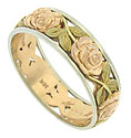 Deeply engraved cutwork rose gold blooms and green gold leaves cover the surface of this antique style wedding band