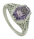 A custom cut amethyst is the star of this elegant 14K white gold engagemement ring