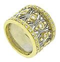This phenomenal estate wedding band features elongated white gold diamond shaped filigree