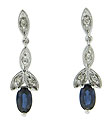 Each of these long and narrow 14K white gold dangle earrings has a sapphire set at the bottom