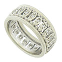 A diamond frosted string of elongated figures dance across the face of this antique wedding band